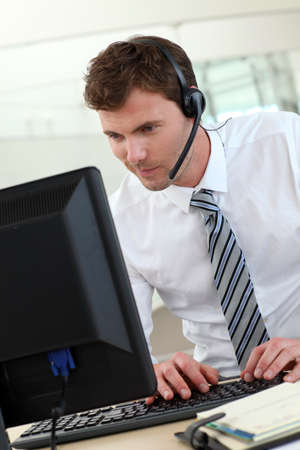 Customer service representative sitting in front of desktop Stock Photo - 13904521