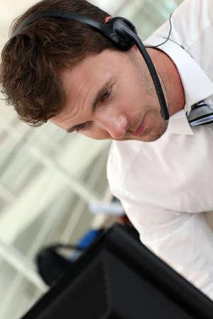 sales representative: Portrait of salesman with headset on Stock Photo