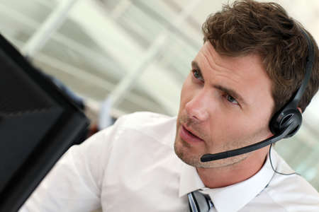 serious businessman: Portrait of salesman with headset on Stock Photo