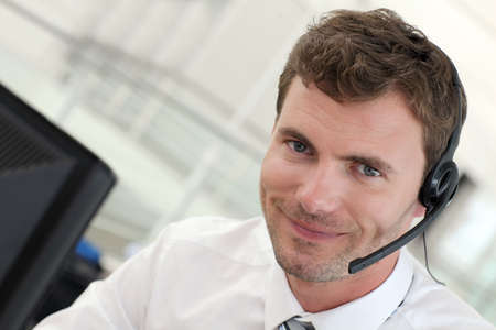 telephone salesman: Portrait of salesman with headset on Stock Photo