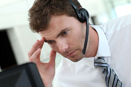 sales call: Portrait of salesman with headset on Stock Photo