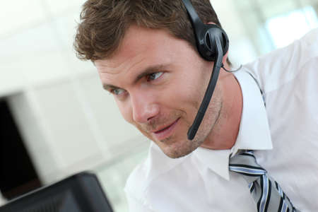 telephone headset: Portrait of salesman with headset on Stock Photo