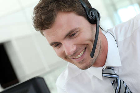 representative: Portrait of salesman with headset on Stock Photo