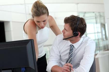 secretary desk: Business people meeting in office in front of desktop