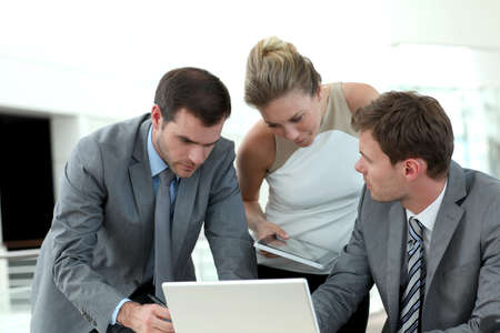 Group of business people meeting around table photo