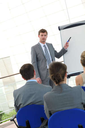 class rooms: Group of people attending business presentation