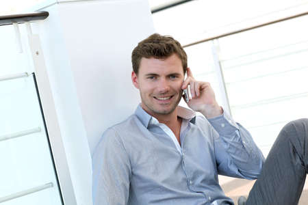 phonecall: Handsome man having phonecall at work