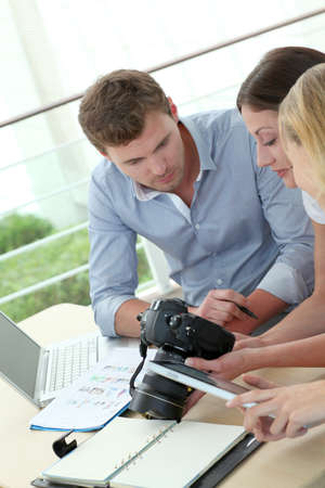 Team of photo reporters working in office Stock Photo - 13904486