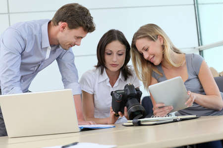 Team of photo reporters working in office photo
