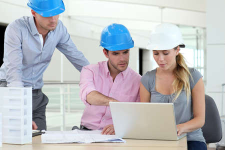 Team of architects working in office Stock Photo - 13904816