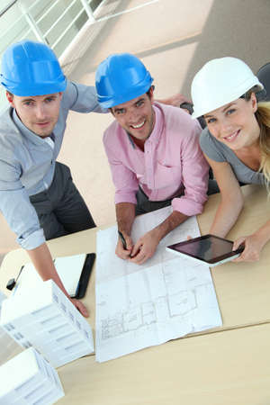Upper view of team of architects working in office photo