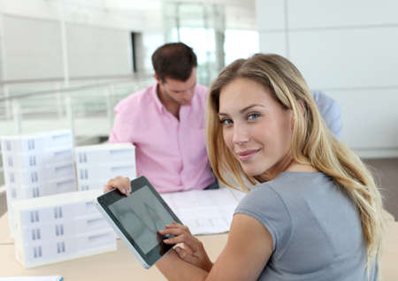 Beautiful woman in office using electronic tablet photo