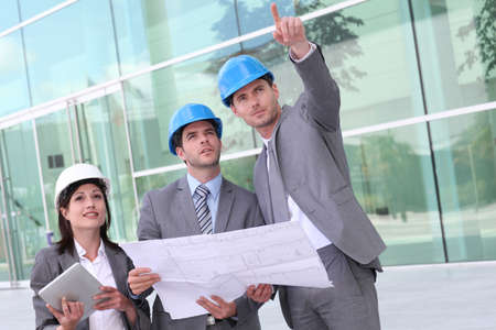 buildingsite: Business people checking construction site