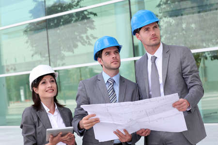 Business people checking construction site  photo