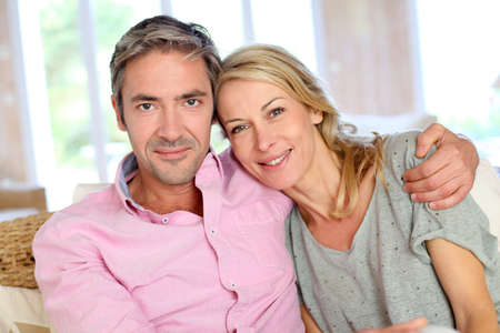 wedding portrait: Middle aged couple relaxing in sofa at home Stock Photo