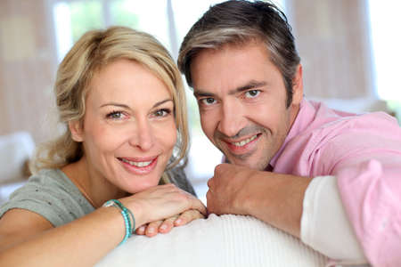 middle aged: Middle aged couple relaxing in sofa at home Stock Photo