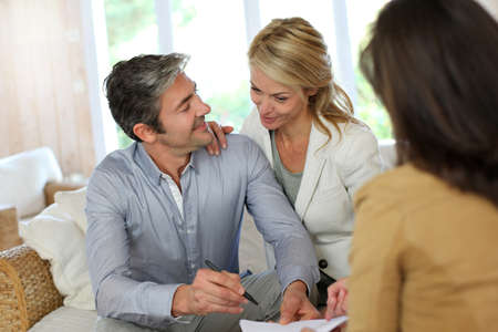 real estate planning: Couple meeting advisor at home