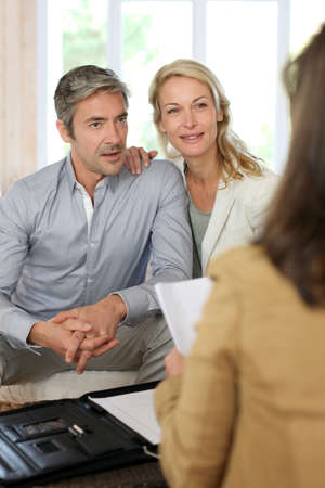 organizer: Couple meeting advisor at home