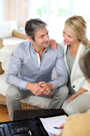 Couple meeting advisor at home photo