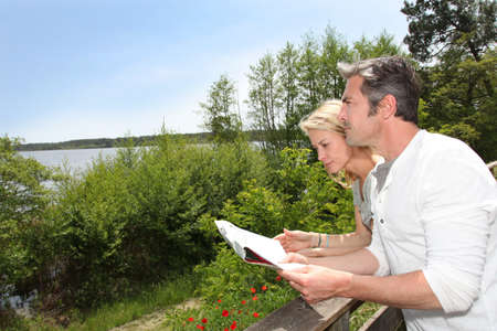 Couple on vacation looking at touristic map  photo