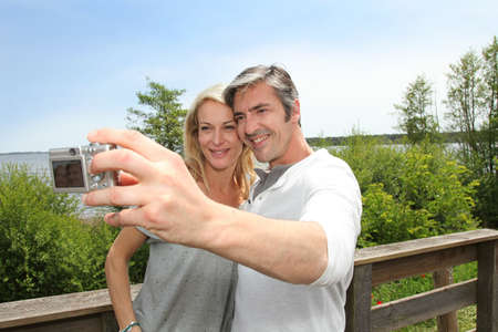 Couple in vacation taking picture of each other photo