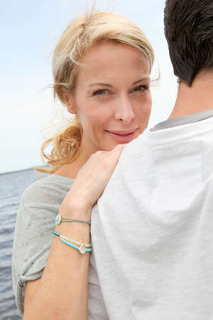 Happy woman relaxing on husbands shoulder photo