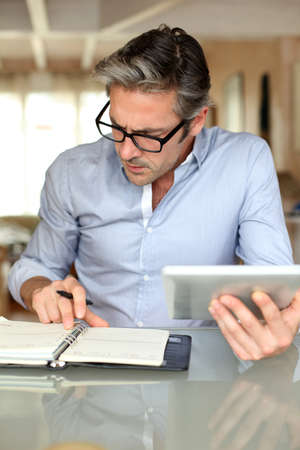 Handsome businessman with eyeglasses working from home Stock Photo