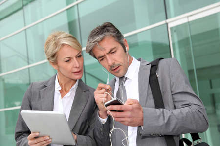 telephone salesman: Business team meeting outside with tablet Stock Photo