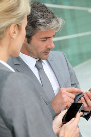 telephone salesman: Business people exchanging phone numbers
