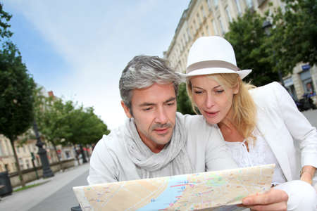 Middle aged couple looking at city map photo