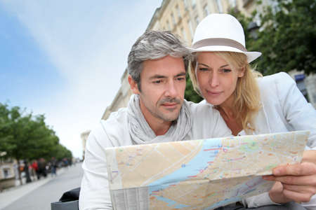 middle aged woman: Middle aged couple looking at city map