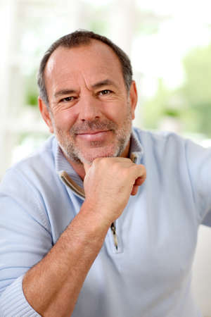 Portrait of senior man sitting in sofa at home Stock Photo - 14022852