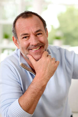 Portrait of senior man sitting in sofa at home Stock Photo - 14023128