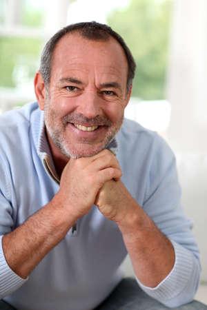 Portrait of senior man sitting in sofa at home Stock Photo - 14023044