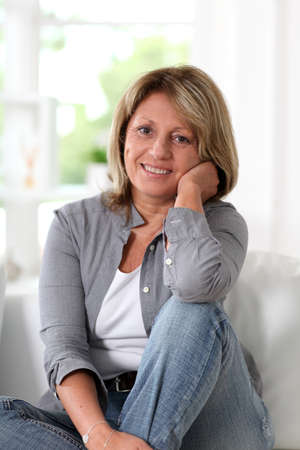 Senior woman at home sitting in sofa Stock Photo - 14023413