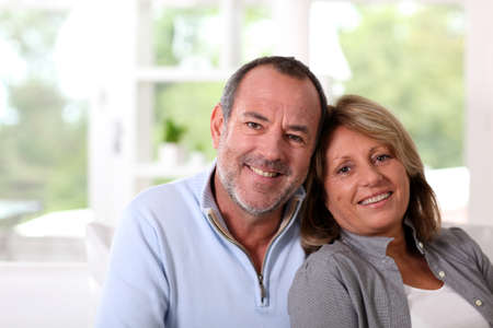 Portrait of happy senior couple sitting in sofa Stock Photo - 14023050