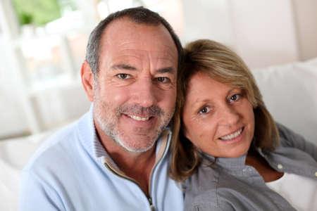 Portrait of happy senior couple sitting in sofa Stock Photo - 14022891
