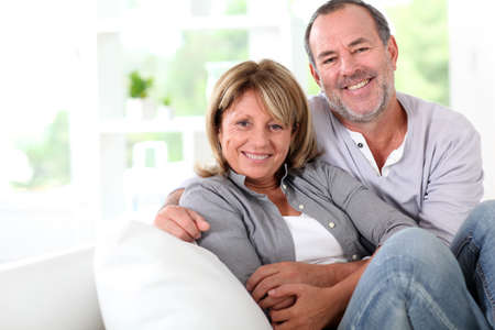 Cheerful senior couple enjoying being at home photo