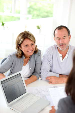 financial adviser: Senior couple ready to buy new house reading contract Stock Photo