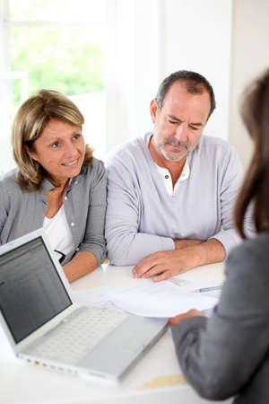 Senior couple ready to buy new house reading contract photo