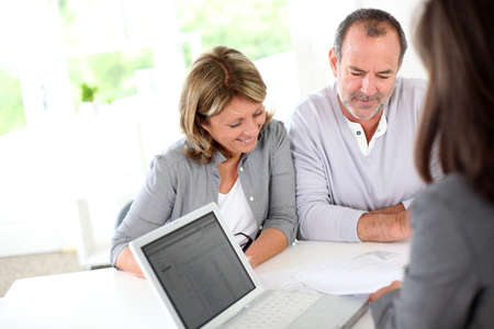 Senior couple ready to buy new house reading contract Stock Photo - 14022844