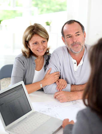 real estate planning: Senior couple ready to buy new house reading contract Stock Photo