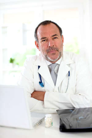 modern doctor: Portrait of mature doctor in uniform