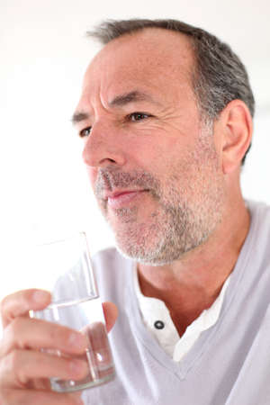 50 years old man: Senior man holding glass of water Stock Photo