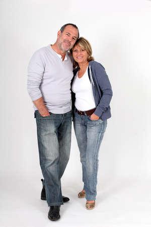 textspace: Modern senior couple standing on white background