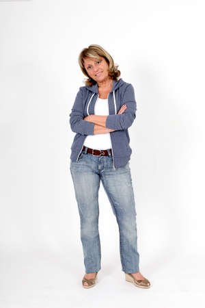 woman standing: Senior woman in blue jeans standing on white background