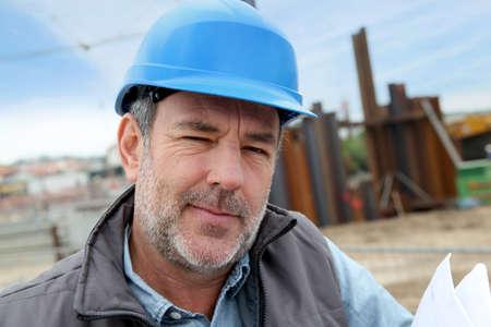 Portrait of entrepreneur on building site photo
