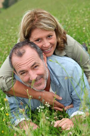 Cheerful retired couple relaxing in countryside Stock Photo - 14024425
