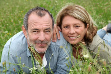 Cheerful retired couple relaxing in countryside photo