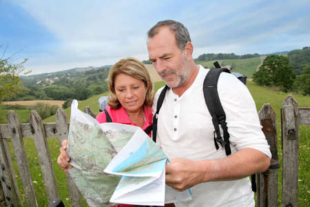Retired people reading map on trekking day Stock Photo - 14024117